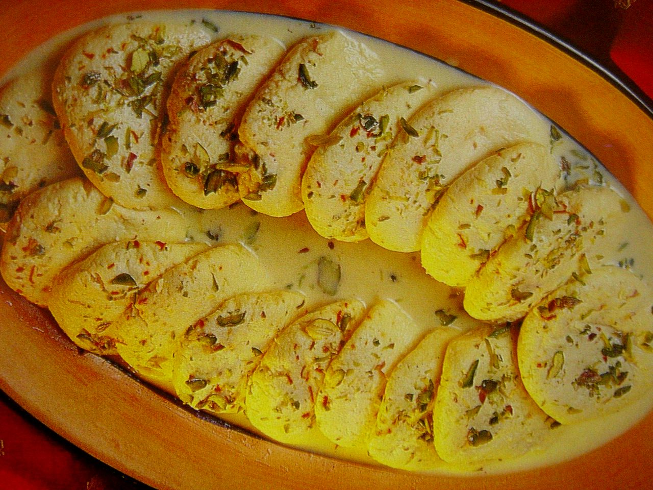 http://bengalicuisine.files.wordpress.com/2008/11/arundhuti_rasmalai.jpg